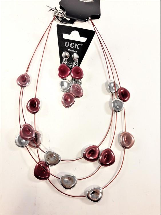 Halsband med detaljer i rött och silverfärg samt örhängen