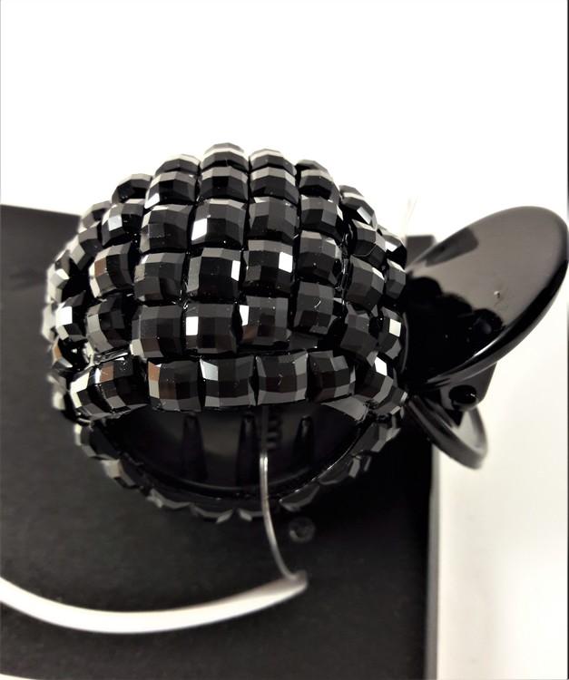 Rund hårklämma med glittrande detaljer i svart