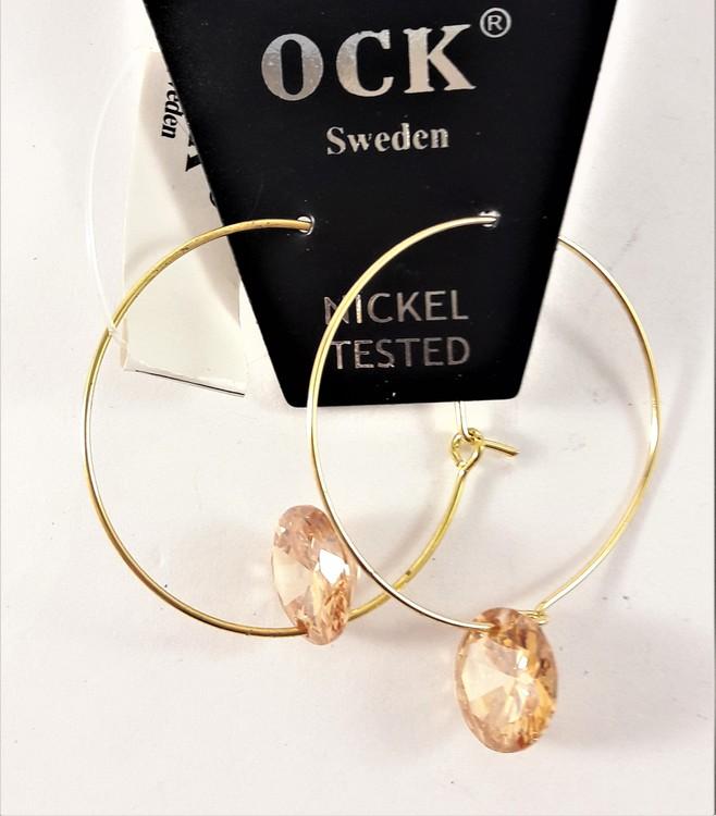 Örhängen med guldfärgad ring och gula detaljer