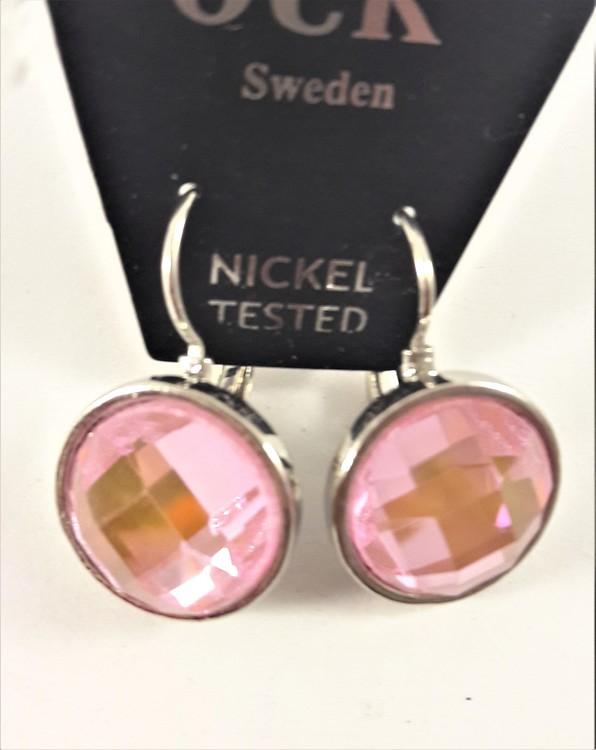 Örhänge med silverfärg och rosa facett