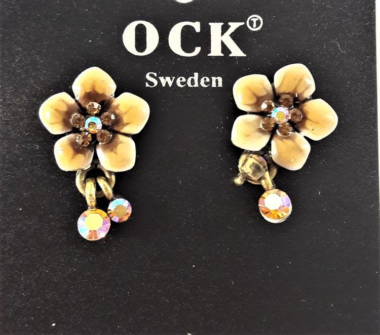 Emaljerat, brunt örhänge i form av fembladig blomma och strass