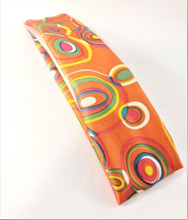 Hårband i glada färger och mönster, elastiskt, orange bottenfärg