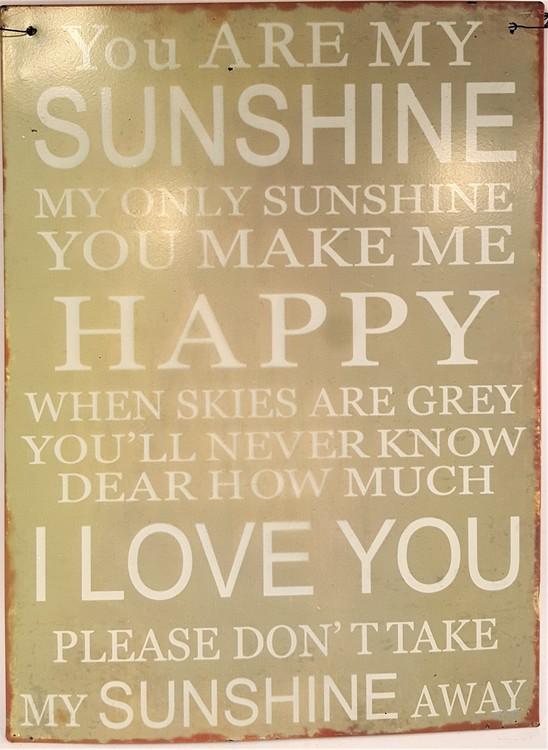"Plåttavla med texten ""You are my sunshine...""."