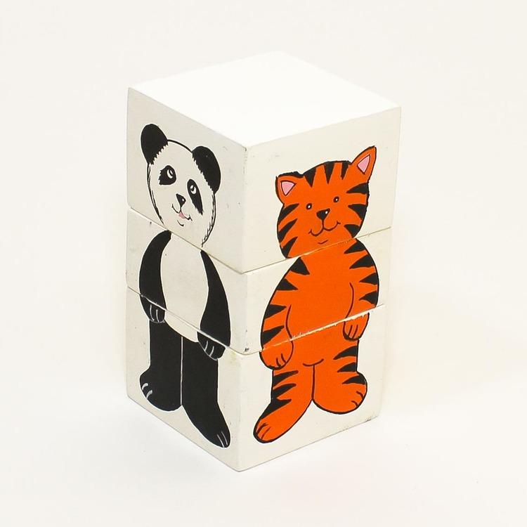 Pussel med 3 vita klossar som kan bli tiger, lejon, leopard, panda eller mittemellan. Här syns panda & tiger.
