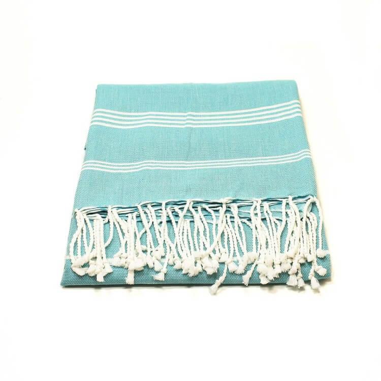 Mjuk & lätt badduk, fouta, hamam. Ljusturkos. God uppsugningsförmåga. Torkar snabbt. Perfekt på stranden & på resan. Även som bordsduk. Ekologisk & Fair Trade.