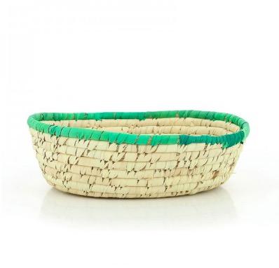Oval påskkorg av palmblad. Kan fyllas med påskgodis, påskägg och små presenter. Fair Trade.