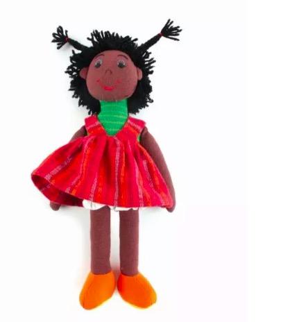 Liten docke med avtagbara klänning och kortbyxor. På bilden påklädd. Handvävd bomull från Sri Lanka, Fair Trade.
