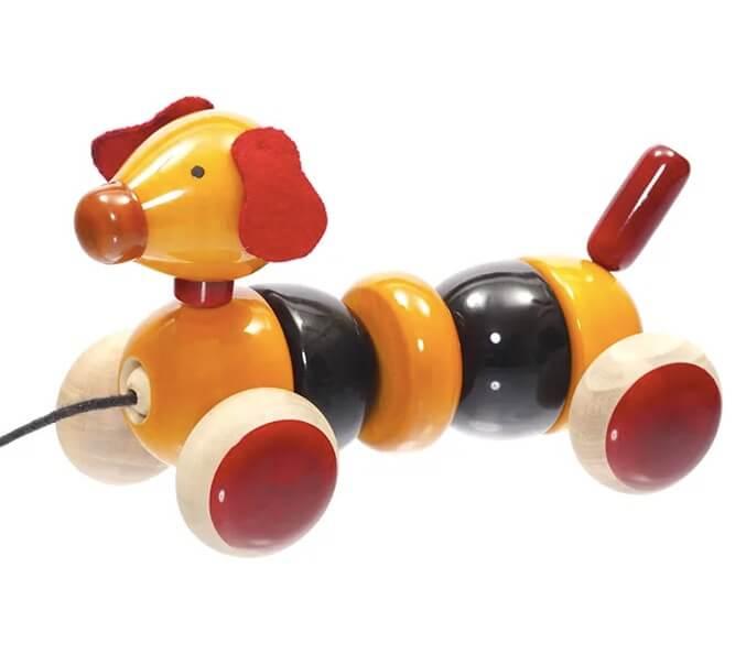 Leksakshund i trä med naturfärger, tålig, olika delar. Rolig och pedagogisk. Till barn äldre än 3 år. Fair Trade.