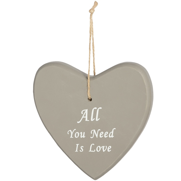 Skylt med text -All You Need Is Love