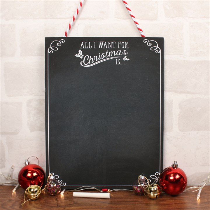 All I want for christmas is.. -Griffeltavla